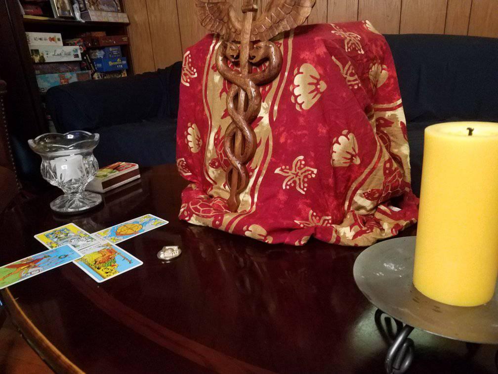 Hermes altar with caduceus and tarot cards.